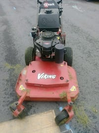 red and black Toro push mower 8 km