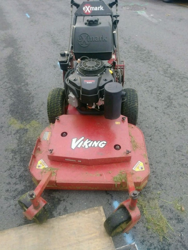 red and black Toro push mower