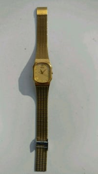 round gold-colored analog watch with link bracelet Fort Myers, 33912