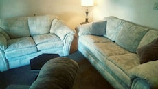 Two white beautiful couches well taken care of pai
