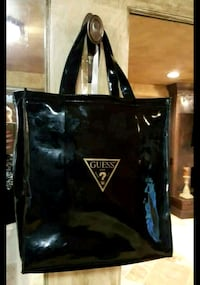 Classic guess black / gold tote Oklahoma City, 73150