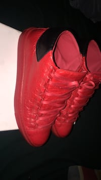 pair of red leather shoes 403 mi