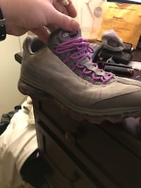 Purple-and-gray nike running shoes. Essex, 21221