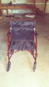 red and black mobility wheel chair. Ocala, 34471