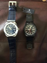two round silver analog watches with black leather straps Wilmington