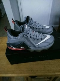 pair of gray Nike running shoes with box Glen Burnie, 21060