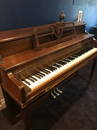 Brown and white upright piano Canton, 30114