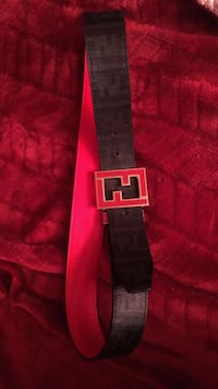 pink, black, and gray Fendi belt