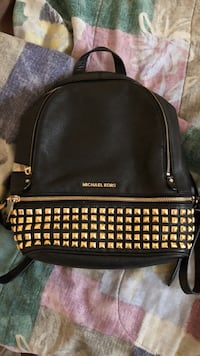 black MK leather studded backpack