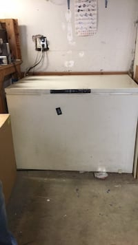 white and black top-load clothes washer 2228 mi