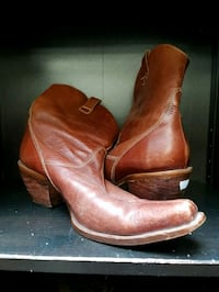 pair of brown leather mid-calf boots