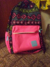 pink, green, and blue backpack