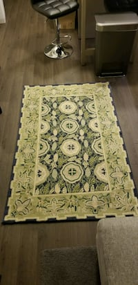 Green and blue floral area rug