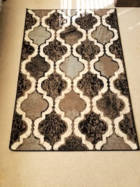 white and black floral area rug 11 km