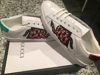 unpaired white and red adidas low-top sneaker El Paso, 79932