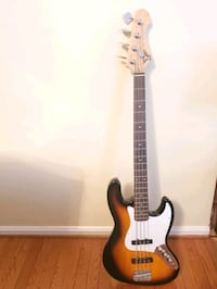 Bass guitar with tuner and headphone amp
