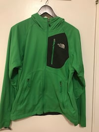 Green and black zip-up jacket 3150 km