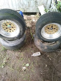 two gray auto wheels with tires