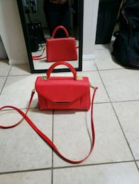 red and black pet carrier Toronto, M8Y 3L1