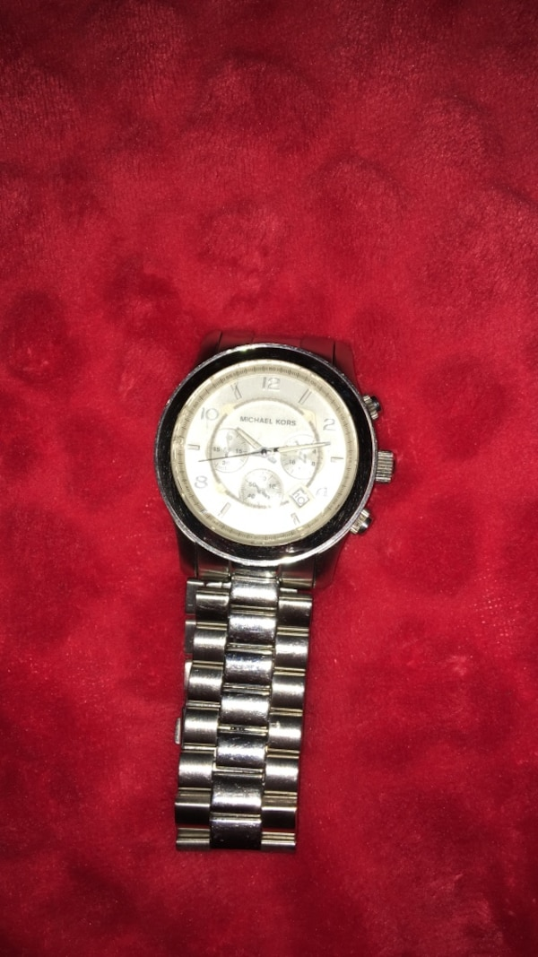 Authentic silver Micheal Kors watch for men
