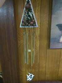 gold-colored metal wind chimes
