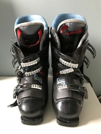 pair of black-and-gray snowboard boots