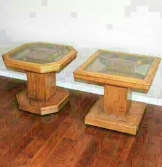 two brown wooden frame clear glass top tables