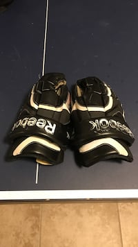 Pair of black-and-white reebok hockey gloves 537 km