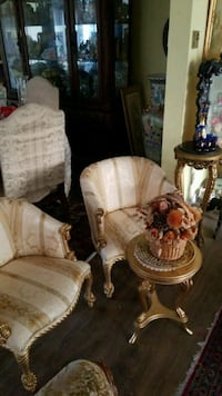 two brown wooden framed beige padded armchairs Montreal, H3R 3L4