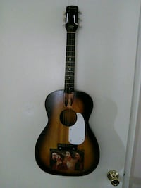 brown and black acoustic guitar Englewood, 80113