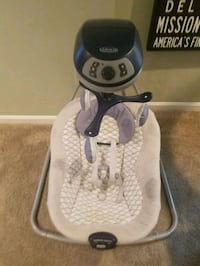 white and black Graco cradle n swing Silver Spring, 20901