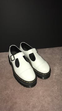 Pair of white-and-black leather loafers Coquitlam, V3E 3C3