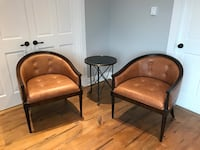 two brown wooden framed brown leather padded armchairs Saint-Philippe, J0L