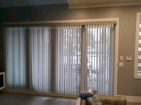 Zebra blinds and round windows in the top part with a same fabric arch
