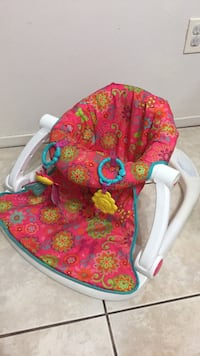 baby's pink and green floral bouncer