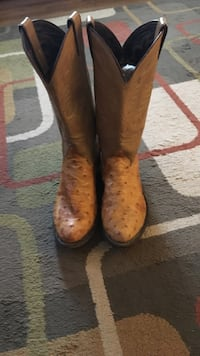 pair of beige ostrich skin leather cowboy boots
