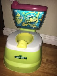 Elmo potty training chair and seat with flush sounds and Elmo voice