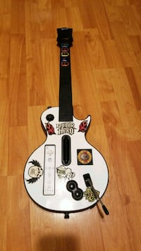 white and red Guitar Hero guitar controller Merced
