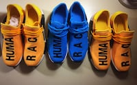 three pairs of blue and yellow Nike shoes