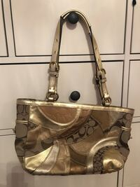 Gold coach purse lightly used  Vaughan, L4J 9B3