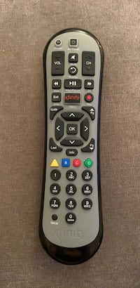 Black and gray Xfinity remote control 16 mi