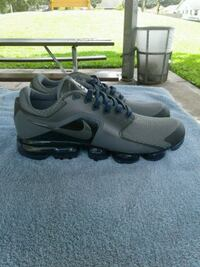 pair of gray Nike running shoes Clearwater, 33755