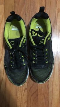 Fils running shoes men's size 10 1/2. Black and green
