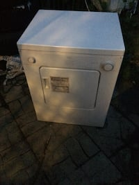 white front-load clothes washer Laval, H7P 4E6