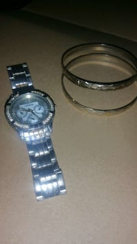 round silver chronograph watch with link strap Toronto