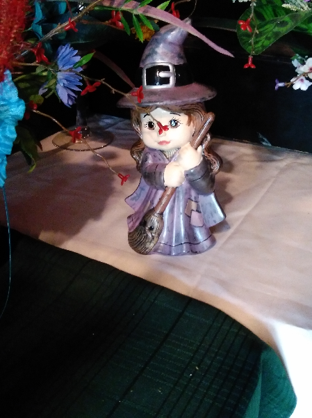 witch in grey dress figurine
