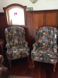 two burgundy & green floral padded wing chairs