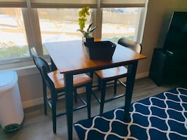 High top dining table with two chairs