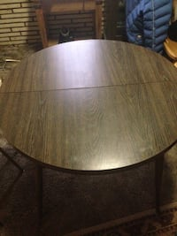 round brown wooden table with chairs Denver, 80219