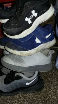 pair of blue-and-white Nike running shoes Garden City, 67846
